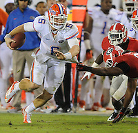Kelly.Jordan@jacksonville.com--102712--Florida Gator quarterback Jeff Driskel, (6), has his shirt grabbed by Georgia's Jarvis Jones, (29), near the line of scrimmage late in the fourth quarter during the annual Georgia-Florida football game at EverBank Field Saturday October 27, 2012 in Jacksonville, Florida. Georgia would go on to beat Florida 17-9.(The Florida Times-Union, Kelly Jordan)