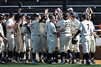 Will Craig (22) of the Wake Forest Demon Deacons is congratulated by his teammates after hitting the first of two 3-run home runs on the day against the Richmond Spiders at David F. Couch Ballpark on March 6, 2016 in Winston-Salem, North Carolina.  The Demon Deacons defeated the Spiders 17-4.  (Brian Westerholt/Four Seam Images)