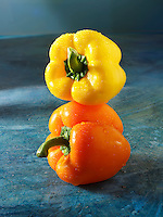 Yellow & orange fresh bell peppers photos, pictures & images