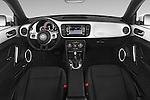 Stock photo of straight dashboard view of a 2015 Volkswagen Beetle - 2 Door Convertible 2WD Dashboard