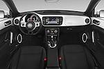 Stock photo of straight dashboard view of a 2015 Volkswagen Beetle - 2 Door Convertible 2WD Dashboard