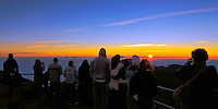 Sunrise atop the crater in HALEAKALA NATIONAL PARK on Maui in Hawaii with male and female tourists