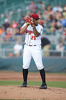 Lansing Lugnuts starting pitcher Maximo Castillo (25) looks to his catcher for the sign against the South Bend Cubs at Cooley Law School Stadium on June 15, 2018 in Lansing, Michigan. The Lugnuts defeated the Cubs 6-4.  (Brian Westerholt/Four Seam Images)