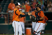 Bowie Baysox pitcher Cristian Alvarado (32) and catcher  Carlos Perez celebrate after closing out an Eastern League game against the Richmond Flying Squirrels on August 15, 2019 at Prince George's Stadium in Bowie, Maryland.  Bowie defeated Richmond 4-3.  (Mike Janes/Four Seam Images)
