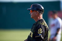San Jose Giants fundamentals coach Gary Davenport (12) coaches first base during a California League game against the Visalia Rawhide on April 13, 2019 at San Jose Municipal Stadium in San Jose, California. Visalia defeated San Jose 4-2. (Zachary Lucy/Four Seam Images)