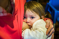 Close-up of a child of about 18 months breastfeeding while looking at the camera.<br /> Lancashire, England, UK<br /> <br /> Date Taken:<br /> 07-01-2015<br /> <br /> © Paul Carter / wdiip.co.uk