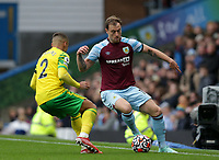 2nd October 2021;  Turf Moor, Burnley, Lancashire, England; Premier League football, Burnley versus Norwich City: Ashley Barnes of Burnley takes on Max Aarons of Norwich City