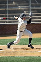 Keegan Maronpot (13) of the Wake Forest Demon Deacons follows through on his swing against the Richmond Spiders at David F. Couch Ballpark on March 6, 2016 in Winston-Salem, North Carolina.  The Demon Deacons defeated the Spiders 17-4.  (Brian Westerholt/Four Seam Images)