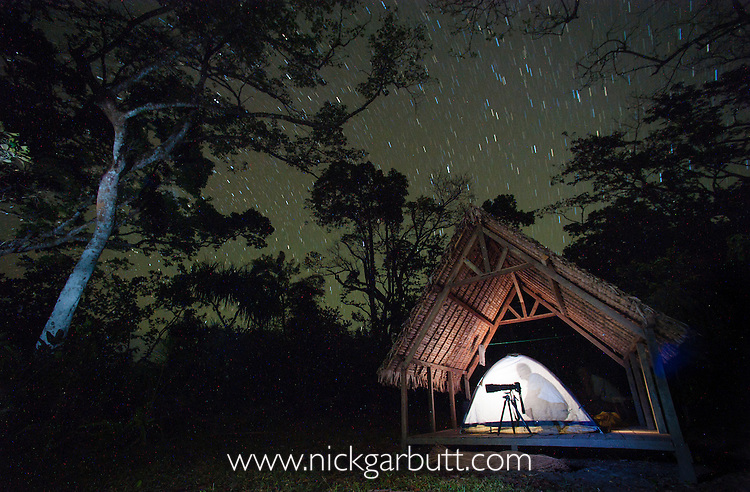 Nick Garbutt preparing for a night's photography. Masoala National Park, Madagascar.