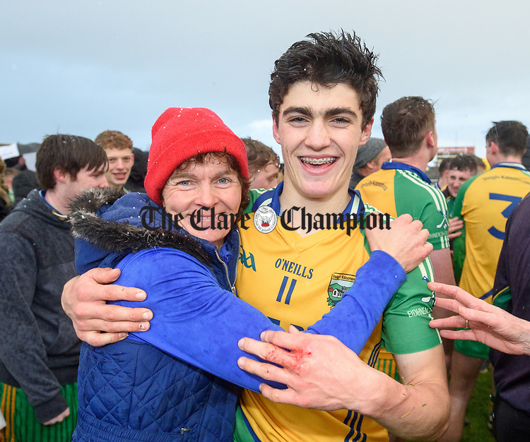 Inagh-Kilnamona player Aidan Mc Carthy celebrates with his mother Patsy  following their Minor A county final win over Kilmaley at Cusack Park. Photograph by John Kelly.