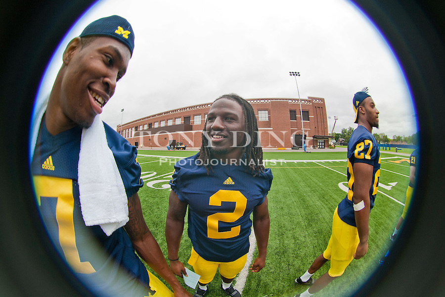 Michigan linebacker Brandin Hawthorne (7) chats with running back Vincent Smith (2) at the annual NCAA college football media day, Sunday, Aug. 22, 2010, in Ann Arbor, Mich. (AP Photo/Tony Ding)