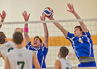 22 February 2015: Yeshiva University Maccabee Middle Blocker Eliakim Gartenberg (4), a Senior from San Jose, CA makes a one-handed block as Middle Blocker Jonathan Shedlo, a Sophomore from Baltimore, MD, making his college athletic debut assists during a game against the Sage College Gators at the Kahl Gymnasium, in Albany, NY. The Maccabees fell to the Gators 3-0 in NCAA Division III Men's Volleyball Skyline play. Mandatory Credit: Ed Wolfstein Photo *** RAW (NEF) Image File Available ***