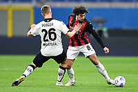 Tommaso Pobega of Spezia and Sandro Tonali of AC Milan compete for the ball during the Serie A football match between AC Milan and Spezia Calcio at San Siro Stadium in Milano  (Italy), October 4th, 2020. Photo Image Sport / Insidefoto