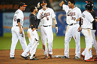 Frederick Keys left fielder Jay Gonzalez (13) celebrates with teammates, including Luis Gonzalez (48), Jonah Heim (6), Jomar Reyes (30), after a walk off base hit during a game against the Carolina Mudcats on June 4, 2016 at Nymeo Field at Harry Grove Stadium in Frederick, Maryland.  Frederick defeated Carolina 5-4 in eleven innings.  (Mike Janes/Four Seam Images)