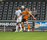 11th September 2021; Swansea.com Stadium, Swansea, Wales; EFL Championship football, Swansea versus Hull City; Ethan Laird of Swansea City and Matt Smith of Hull City challenge for the ball