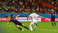 With an open goal infront of him, Fernando Torres of Spain chooses to cut back on his right foot rather than to shoot, allowing Joel Veltman of Netherlands to make a last ditch tackle
