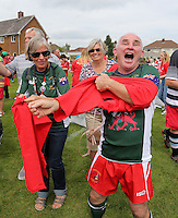 Pictured: Some of the participants in Cardiff, Wales, UK. Wednesday 24 August 2016<br /> Re: The largest rugby scrum has been achieved by Golden Oldies at University Fields in Cardiff south Wales, UK. It was refereed by welsh international referee Nigel Owens. Guinness World Records has verified the new record in which 1297 people took part in.