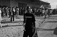Port Au Prince, Haiti, Jan 19, 2010.Thousands of unemployed men are trying to find a job with the UN or foreign NGO's and converge to the airport in that purpose..