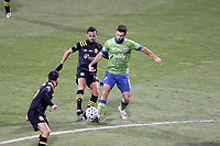 COLUMBUS, OH - DECEMBER 12: Will Bruin #17 of the Seattle Sounders FC and Artur #8 of the Columbus Crew challenge for the ball during a game between Seattle Sounders FC and Columbus Crew at MAPFRE Stadium on December 12, 2020 in Columbus, Ohio.