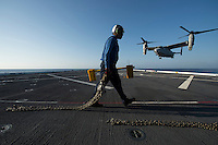 130423-N-DR144-716 Pacific Ocean (April 23, 2013)- Aviation Boatswain's Mate Airman Timothy Davis prepares to chock and chain an MV-22 Osprey assigned to Marine Medium Tiltrotor Squadron (VMM) 161 as it lands on the flight deck of the Amphibious Transport Dock Ship USS Anchorage (LPD 23). Anchorage is currently en route to its namesake city of Anchorage, Alaska for its commissioning ceremony May 4. (U.S. Navy photo by Mass Communication Specialist 1st Class James R. Evans / RELEASED)