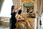 Former film actress and one of Vietnam's wealthiest women, Thuy Tien is the president of Imex Pan Pacific, a trading company that runs over 26 major businesses, including shopping malls, duty free fashion designer boutiques. Pictured here in a Ferragamo silk organza gown in her bedroom with her make-up artist and hairstylist in high security riverside villa in Anphu, Saigon, a residential enclave with rich Vietnamese and expats.