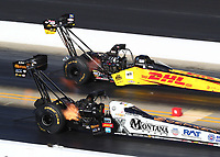 Oct 14, 2019; Concord, NC, USA; NHRA top fuel driver Austin Prock (near) alongside Richie Crampton during the Carolina Nationals at zMax Dragway. Mandatory Credit: Mark J. Rebilas-USA TODAY Sports