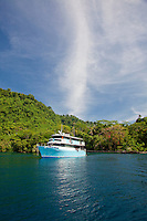 Live aboard dive boat MV Febrina at anchor inside a submerged volcanic crater on Garove island in the Witu Islands off New Britain, Papua New Guinea.