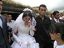 Armenia 2007 <br /> A Yezidi wedding in a village: the bride leaving her village <br /> Armenie 2007 <br /> Un mariage yezidi , la mariée quitte son village accompagnée d'un homme de sa famille