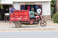 Tanzania, Mto wa Mbu Street Scene.  Transporting Soft Drinks in Town.