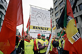 100,000 trade unionists march through Brussels to protest at proposed redundancies at Renault car factories in Belgium and France