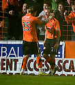 :: DUNDEE UTD'S JOHNNY RUSSELL IS CONGRATULATED BY DAVID GOODWILLIE AFTER HE SCORES THE SECOND ::