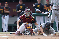 Garrett Stubbs #51 of the USC Trojans tags the runner out at the plate during a game against the Cal Poly Mustangs at Dedeaux Field on March 2, 2014 in Los Angeles, California. Cal Poly defeated USC, 5-1. (Larry Goren/Four Seam Images)