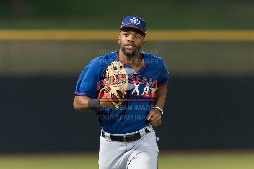 AZL Rangers left fielder Marcus Mack (17) jogs off the field between innings of an Arizona League game against the AZL Giants Black at Scottsdale Stadium on August 4, 2018 in Scottsdale, Arizona. The AZL Giants Black defeated the AZL Rangers by a score of 6-3 in the second game of a doubleheader. (Zachary Lucy/Four Seam Images)