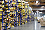 Large warehouse with freight stacked to ceiling.