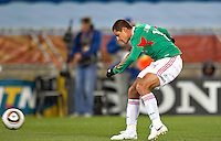 Javier Hernandez of Mexico scores the opening goal against France.