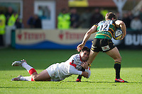 20121027 Copyright onEdition 2012©.Free for editorial use image, please credit: onEdition..Brad Barritt of Saracens hangs onto Dom Waldouck of Northampton Saints during the Aviva Premiership match between Northampton Saints and Saracens at Franklin's Gardens on Saturday 27th October 2012 (Photo by Rob Munro)..For press contacts contact: Sam Feasey at brandRapport on M: +44 (0)7717 757114 E: SFeasey@brand-rapport.com..If you require a higher resolution image or you have any other onEdition photographic enquiries, please contact onEdition on 0845 900 2 900 or email info@onEdition.com.This image is copyright the onEdition 2012©..This image has been supplied by onEdition and must be credited onEdition. The author is asserting his full Moral rights in relation to the publication of this image. Rights for onward transmission of any image or file is not granted or implied. Changing or deleting Copyright information is illegal as specified in the Copyright, Design and Patents Act 1988. If you are in any way unsure of your right to publish this image please contact onEdition on 0845 900 2 900 or email info@onEdition.com