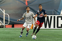 FOXBOROUGH, MA - SEPTEMBER 23: Jorge Corrales #26 of Montreal Impact passes the ball as Brandon Bye #15 of New England Revolution defends during a game between Montreal Impact and New England Revolution at Gillette Stadium on September 23, 2020 in Foxborough, Massachusetts.