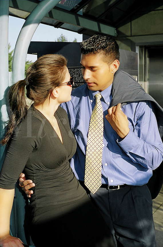 Young multi-ethnic business couple flirt with each other..MR