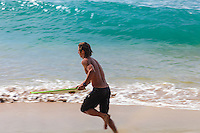 A skimboarder about to meet the waves at Ka'anapali Beach on Maui.