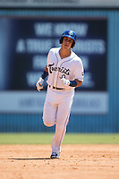 Dom Nunez (9) of the Asheville Tourists rounds the bases after hitting a home run against the Rome Braves at McCormick Field on July 26, 2015 in Asheville, North Carolina.  The Tourists defeated the Braves 16-4.  (Brian Westerholt/Four Seam Images)