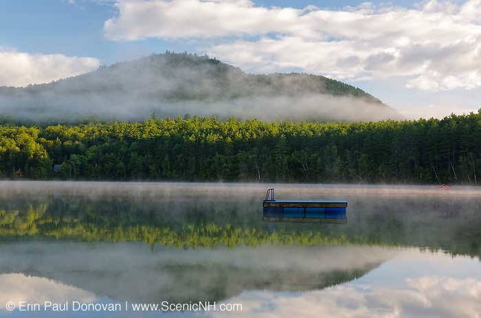 Mirror Lake in Woodstock, New Hampshire USA on a foggy summer morning.