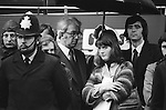 """Harriet Harman as a young solicitor Grunwick Strike London 1977. On the Picket Line. She is holding a """"Brent Community Law Centre """" brochure. Lawyer in glasses and tie. <br /> <br /> Lawyer (in glasses) listening in behind Harriet Harman is John Bowden.<br /> <br /> Lawyer Jeremy Smith behind Harriet Harman took over her role at Brent Community Law centre when she moved on. Jeremy Smith  went on amongst other things to run Advocacy International."""