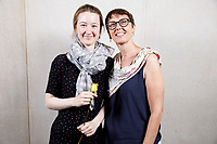 Contestant Mathilde Wauters of Belgium poses with guest at a photo booth during the opening reception and dinner of the 11th USA International Harp Competition at Indiana University in Bloomington, Indiana on Wednesday, July 3, 2019. (Photo by James Brosher)