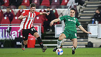 Joey Pelupessy of Sheffield Wednesday in possession as Brentford's Vitaly Janelt gets ready to make a challenge during Brentford vs Sheffield Wednesday, Sky Bet EFL Championship Football at the Brentford Community Stadium on 24th February 2021