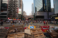 Barricades are seen in the middle of an interesction controlled by pro-democracy protesters in Mong Kok, on the second day of the mass civil disobedience campaign Occupy Hong Kong, Mong Kok, Kowloon, Hong Kong, China, 30 September 2014. The movement is also being dubbed the 'umbrella revolution' after the versatile umbrellas used to shield protesters from rain, sun - and police pepper spray.