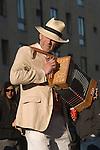 Man playing folk music accordion player Oxford,  Oxfordshire May Morning.