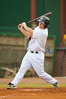 Nate Roberts #19 of the Elizabethton Twins follows through on his swing against the Greeneville Astros at Joe O'Brien Field August 15, 2010, in Elizabethton, Tennessee.  Photo by Brian Westerholt / Four Seam Images