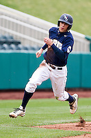 Joey Winiecki (11) of the Oral Roberts Golden Eagles rounds third base during a game against the /m/ on March 27, 2011 at Hammons Field in Springfield, Missouri.  Photo By David Welker/Four Seam Images