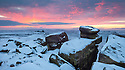 Sunrise over White Tor on Derwent Edge, looking on towards the Wheel Stones. Peak District National Park, January.