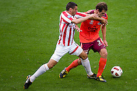 MELBOURNE, AUSTRALIA - NOVEMBER 14: John Aloisi of the Heart challenges Luke DeVere of the Roar during the round 14 A-League match between the Melbourne Heart and Brisbane Roar at AAMI Park on November 14, 2010 in Melbourne, Australia (Photo by Sydney Low / Asterisk Images)